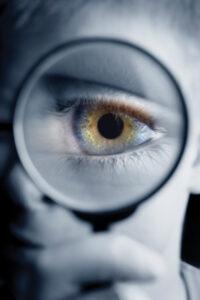 eye behind magnifying glass